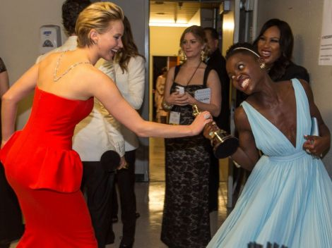 Jennifer Lawrence and Lupita Nyong'o share laughs backstage at last night's Oscars